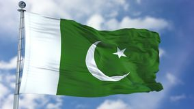 Pakistan Flag in a Blue Sky. Use this clip loud and proud to express loyalty and love to our country. It is a seamless loop with luma channel Royalty Free Stock Image