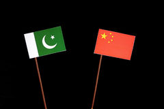 Pakistan flag with Chinese flag  on black. Background Stock Photos