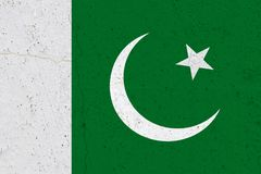 Pakistan flag on concrete wall. Patriotic grunge background. National flag of Pakistan royalty free stock image