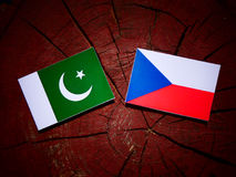 Pakistan flag with Czech flag on a tree stump. Pakistan flag with Czech flag on a tree stump Stock Images