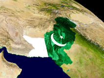 Pakistan with flag on Earth Stock Image