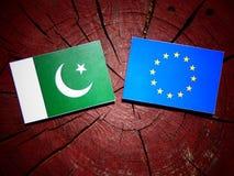 Pakistan flag with EU flag on a tree stump isolated Stock Photography