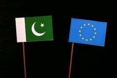 Pakistan flag with European Union EU flag  on black Royalty Free Stock Photo