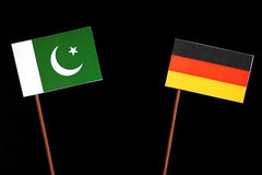 Pakistan flag with German flag  on black. Background Stock Images