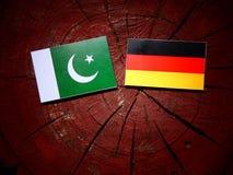 Pakistan flag with German flag on a tree stump  Stock Image