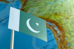 Pakistan flag with a globe map as a background Stock Photos
