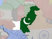 Pakistan with flag on globe Stock Photo