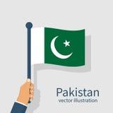 Pakistan flag holding in hand man. Stock Photo
