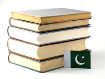 Pakistan flag with pile of books  on white background Stock Photo