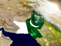 Pakistan with flag in rising sun Stock Photo
