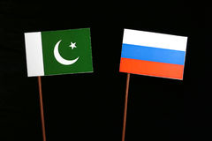 Pakistan flag with Russian flag  on black. Background Stock Images