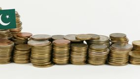 Pakistan flag with stack of money coins. Pakistan flag waving with stack of money coins stock footage