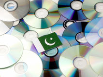 Pakistan flag on top of CD and DVD pile isolated on white. Pakistan flag on top of CD and DVD pile isolated Royalty Free Stock Photos