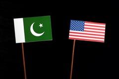 Pakistan flag with USA flag  on black Stock Image
