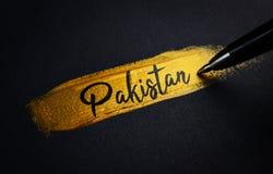 Pakistan Handwriting tekst na Złotym farby muśnięcia uderzeniu zdjęcie stock