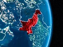 Pakistan im Rot nachts stockbild