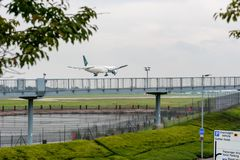 LONDON, ENGLAND - SEPTEMBER 27, 2017: Pakistan International Airlines Boeing 777 AP-BID landing in London Heathrow International A. Pakistan International Stock Photography