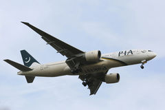 Pakistan International Airlines Boeing 777 in New York sky before landing at JFK Airport  Royalty Free Stock Photo