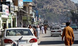 Pakistan daily life. Pakistan. November 5th 2011.Busy road in Mingora town the main town in Swat Valley, Northern Pakistan Stock Photo