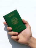 Pakistan Passport. A Hand Holding Passport of Pakistan Stock Images