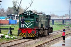 Free Pakistan Railways Locomotive Engine Passes As Small Child Watches Stock Images - 54063654