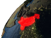 Pakistan in red on Earth at night Royalty Free Stock Images