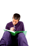 Pakistan schoolboy is studying Stock Image