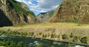 Pakistan: Steep banks of the mountain river stock images
