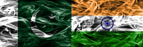 Pakistan vs India smoke flags placed side by side. Thick colored. Silky smoke flags of Pakistan and India stock images