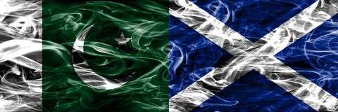 Pakistan vs Scotland smoke flags placed side by side. Thick colo stock photo