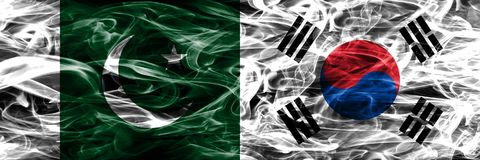 Pakistan vs South Korea smoke flags placed side by side. Thick c stock photography