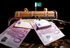 Pakistani flag on top of crate. Full of money Royalty Free Stock Photos