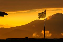 Pakistani Flag waving in the mountains of Mansehra. A dramatic shot of a waving Pakistani flag in the mountains of Mansehra, Pakistan stock photography