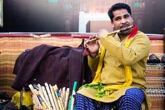 Pakistani Flute Player. Playing flute in traditional Punjabi dress Stock Photos