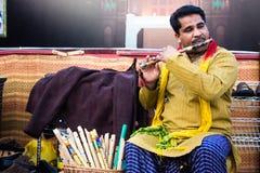 Pakistani Flute Player. Playing flute in traditional Punjabi dress Stock Photo