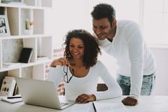 Pakistani Freelancer with Wife Working at Home. royalty free stock photos