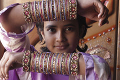 Pakistani girl. Teenage girl showing tradition bridal bangles Stock Photos