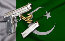 Pakistani Gun Laws flag with pistol gun and bullet Stock Image