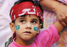 A Pakistani Kid. A face from a demonstration by Imran Khan stock image