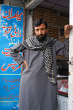 Pakistani man in front of nut shop in Gilgit,Northern Pakistan Stock Photography