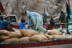 Pakistani man working at the boat,Attabad Lake, Pakistan Stock Photos