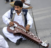 Pakistani performer. Perform folk music in the 1st International Festival of the Intangible Cultural Heritage China,2007 on May 23, 2007 in chengdu, china Royalty Free Stock Image