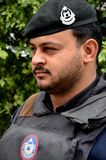 Pakistani police officer with beret Peshawar Pakistan. Peshawar, Pakistan - March 3, 2015: A Pashtun policeman from the Khyber Pukhtoonkhwa provincial police royalty free stock image