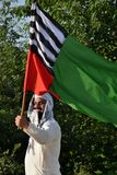 Pakistani religious political activist waves party flag at rally Stock Photography