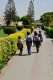 Pakistani schoolchildren with backpacks and uniforms walk towards classes Karachi Pakistan