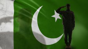Pakistani soldier silhouette saluting against national flag, army special forces. Stock footage stock video