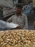 Pakistani Street Food. A Pathan Seller is selling Roasted Chickpeas on a street kisosk at Sadar, Karachi, Pakistan Stock Photography