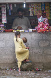 Pakistani street shop. A girl with a little boy at shop royalty free stock images