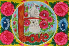Pakistani Truck Art Pigeon and Love. Truck painting is a popular form of indigenous art in Pakistan and featuring floral patterns and poetic calligraphy. Truck stock photo
