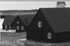 Pakkhusid black wooden warehouses. stock images